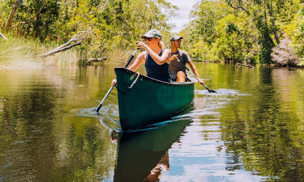 Everglades couple on canoe