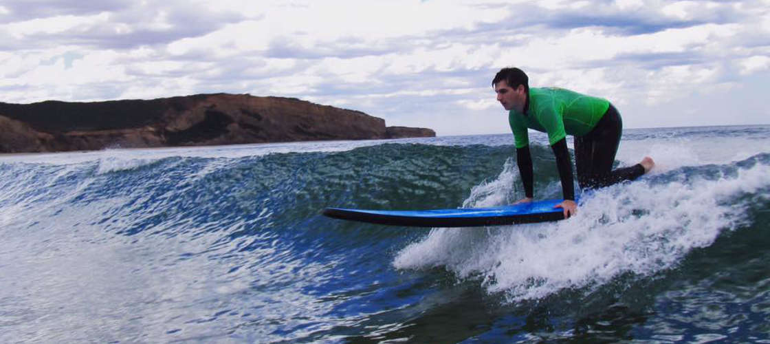 Getting ready to stand while Surfing Great Ocean Road