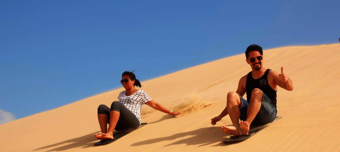Go Sand Boarding with Port Stephens 4WD Tours