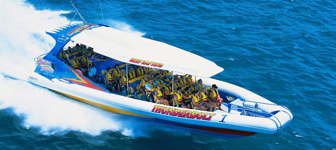 raging thunder fitzroy island thunderbolt reef rafting boat